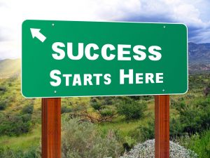 """Road sign, """"success starts here"""" - getting started with your affirmative action plan"""
